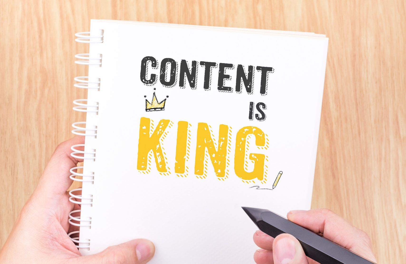 Content is King work on white ring binder notebook with hand hol